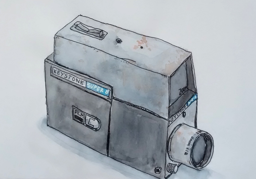 Old Super 8 film camera covered with rust