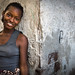 Smiling girl in Grande hotel in Beira, Mozambique by Eric Lafforgue