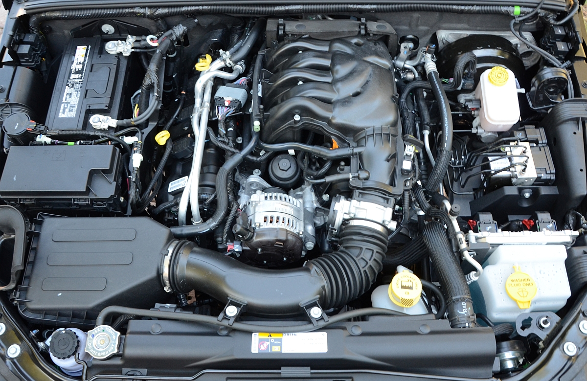 With engine cover removed. Compared to previous generations (TJ, YJ, and  CJ), there is not alot of open space in the JK engine bay.