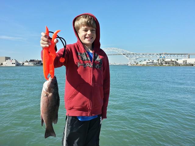 Logan and dad fishing in corpus christi explore for Fishing in corpus christi texas