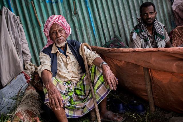 muslim man the sale of qat (natural plant drug) at the bati market