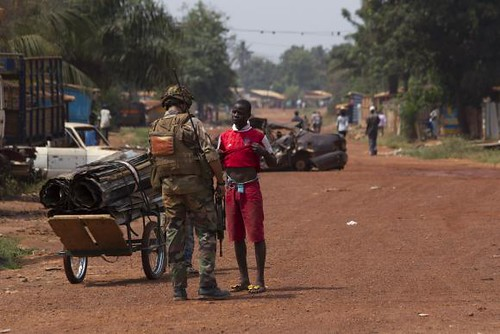 French soldier searches Central African Republic resident in the capital of Bangui. Violence has continued despite the intervention of thousands of foreign troops. by Pan-African News Wire File Photos