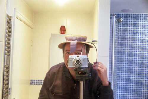 reflected self-portrait with Zeiss Ikonette camera and under-sized boater by pho-Tony