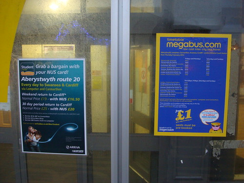 Arriva and Stagecoach Megabus posters on Aberystwyth bus station stand 7