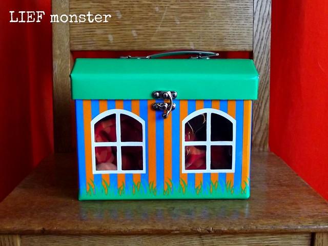 Orange drag-along-bunny in his cardboard house