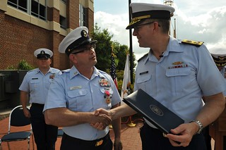 Presented the Legion of Merit Medal, Master Chief Petty Officer Steven W. Cantrell is congratulated by Coast Guard Atlantic Area Commander Vice Adm. Robert C. Parker during the Command Master Chief Change of the Watch ceremony May 15, 2014 in Portsmouth, Virginia.  The Legion of Merit is awarded to any member of the Armed Forces of the United States or a friendly foreign nation who has distinguished himself or herself by exceptionally meritorious conduct in the performance of outstanding services and achievements. U.S. Coast Guard photo by Senior Chief Petty Officer Sarah B. Foster.