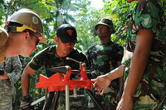A Seabee from Naval Mobile Construction Battalion 1 works with Indonesian counterparts to install parts for a solar pump during an advance party engagement with members of the 30th Naval Construction Regiment in Rote, Indonesia, May 14. (U.S. Navy/Lt. Julianne Holland)