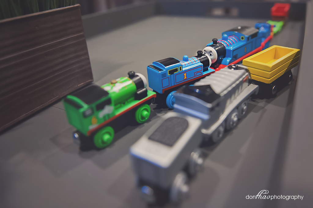 personal 365 - ocd toddler lining up train toys photography