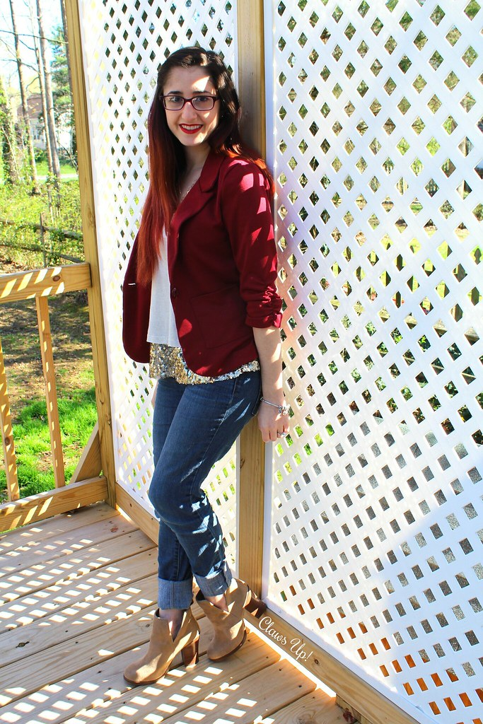 Red blazer, gold sequin top, and beige booties.