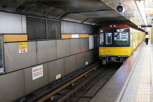 old-style colored Ginza line subway train