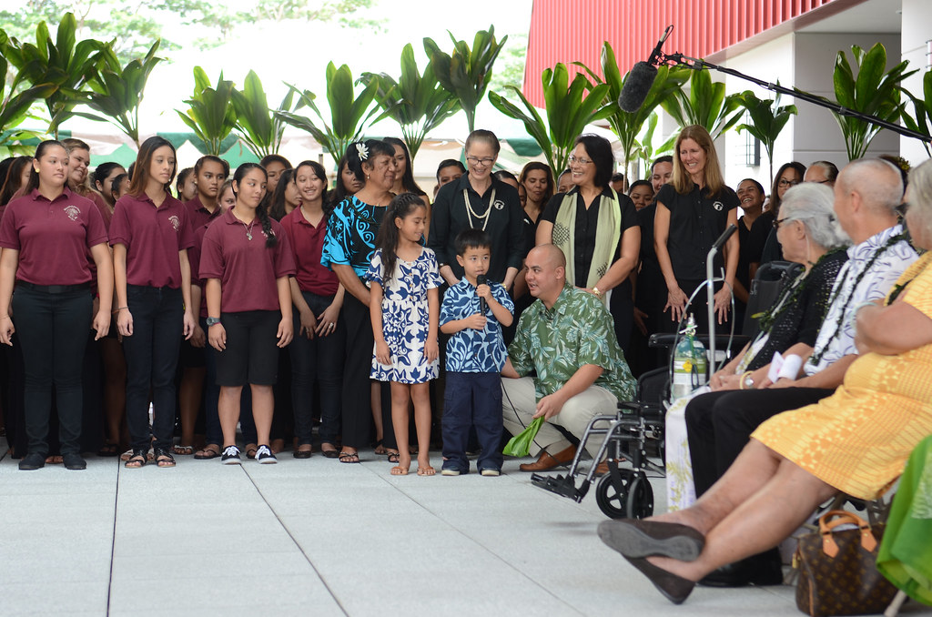 <p>Pūnana Leo student Kahaʻiʻōlelo Helm introduces himself in Hawaiian before hundreds of people during the grand opening of UH Hilo's new home for the school's Ka Haka 'Ula O Ke'elikōlani College of Hawaiian Language.</p>