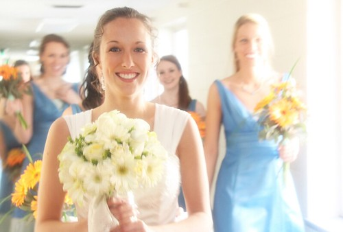 Bride smiling at wedding with bridemaids