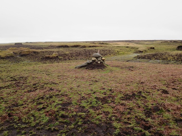 Small cairn with post on summit plateau, Kinder Scout, Peak District