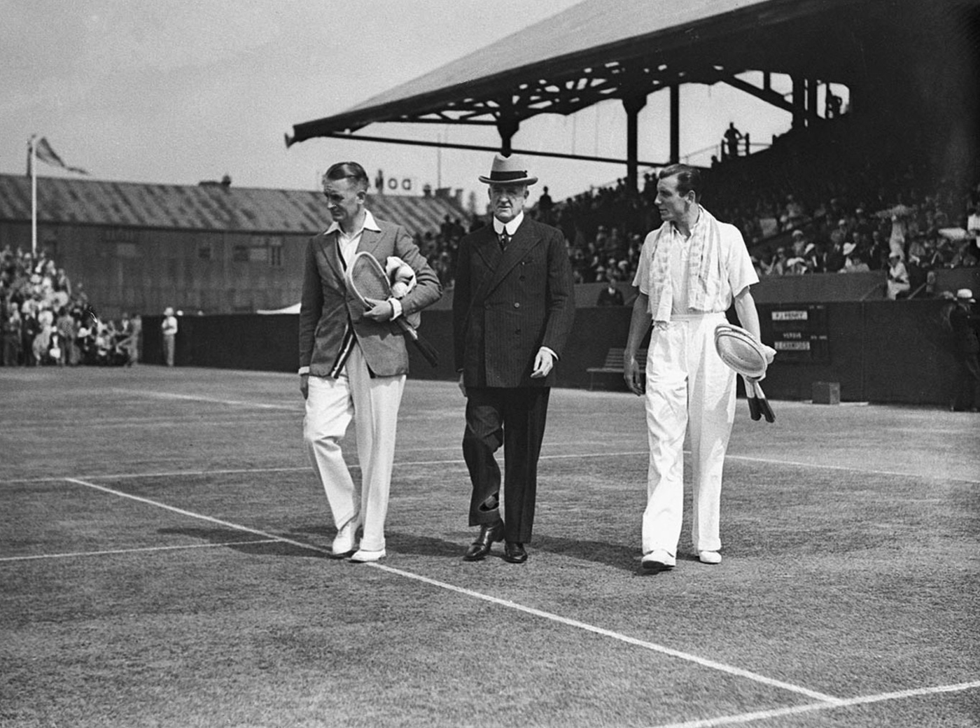 Australian tennis player Jack Crawford (left) and British tennis player Fred Perry (right) at the White City Stadium in Sydney, Australia with a senior tennis offical (center) 1930s