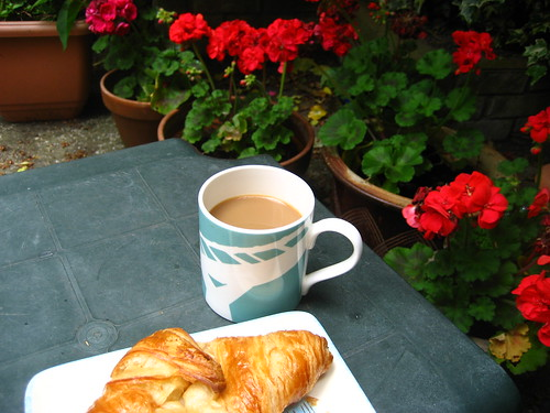 Coffee and croissant in the garden
