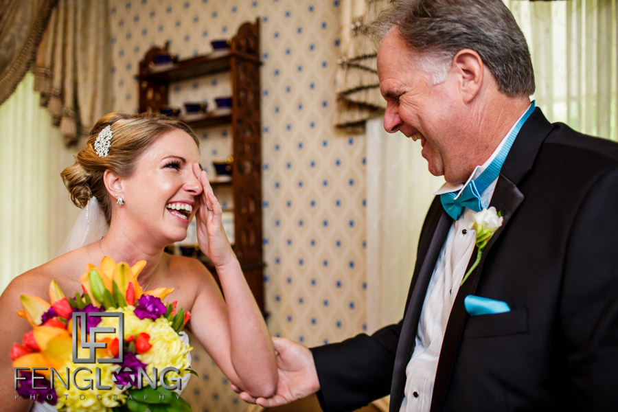 Bride and her father laugh and cry together before the ceremony