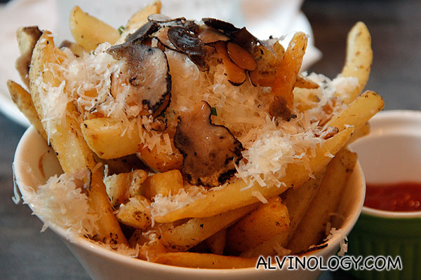 TRUFFLE FRIES (Thick cut French fries seasoned with white  truffle oil and topped with shaved truffles) - S$6.90