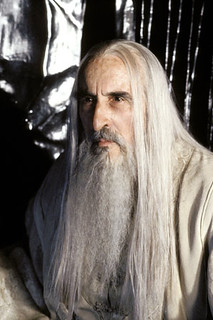 Saruman has long white hair and deep wrinkles