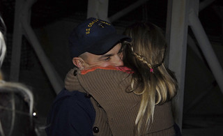 Petty Officer 1st Class John Savasta, assigned to Coast Guard Cutter Waesche, hugs his daughter at Coast Guard Island in Alameda, Calif., Friday, November 29, 2013. The Waesche's crew returned from a 109-day deployment in Gulf of Alaska, Bering Sea and Artic Ocean to its homeport at Coast Guard Island to reunite with loved ones for the holidays. U.S. Coast Guard photo by Petty Officer 3rd Class Loumania Stewart