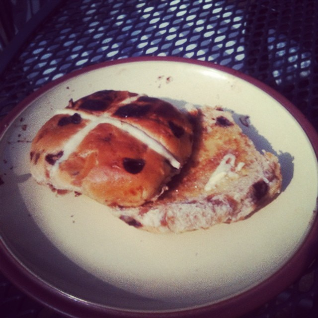 Enjoying a yummy chocolate and toffee hot cross bun for brekkie :)