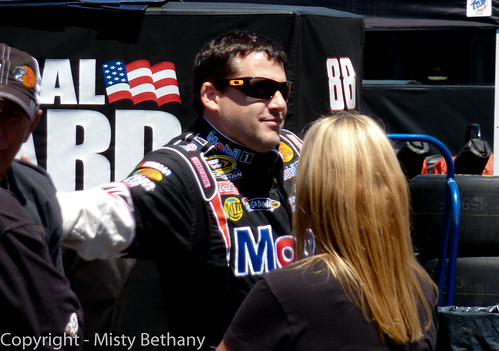 Tony Stewart playfully slaps his dad