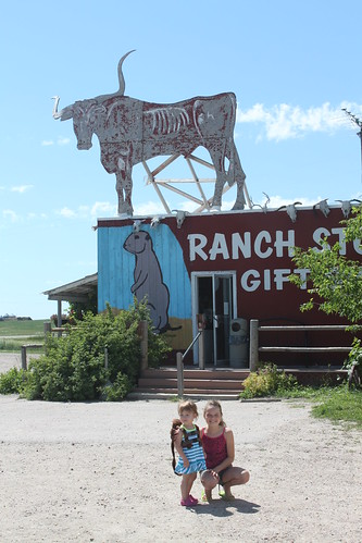 nati and vali near the ranch store sign