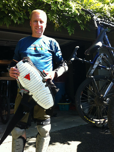 Putting on my biking gear (Scott took the picture)