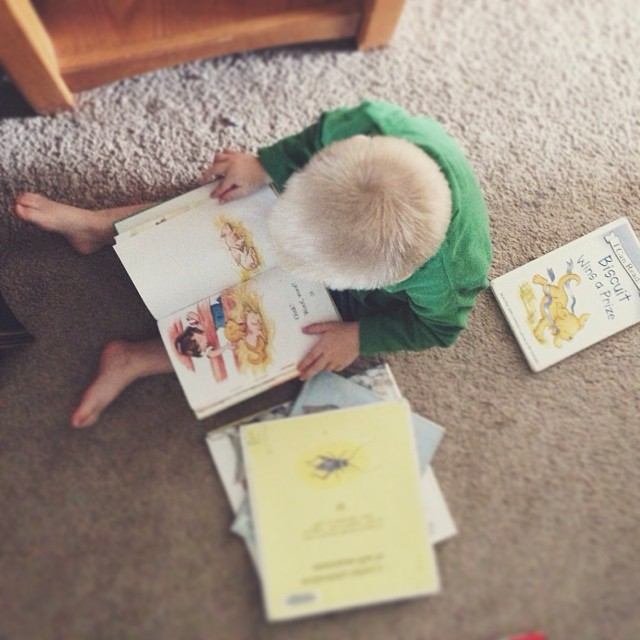 Mommy is planning menus & grocery shopping lists. Eli is looking at some of his favorite books. Love this sweet boy!