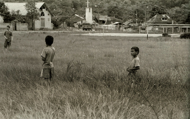 boys in a field near bosque nublado; Ecuador (1997)