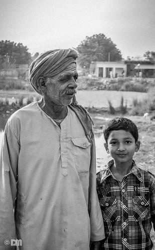 old bw man rural kid grain mirza daniyal