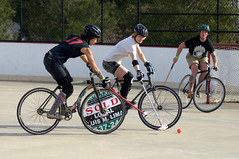 endurance sports(0.0), keirin(0.0), racing bicycle(0.0), road bicycle(1.0), vehicle(1.0), sports(1.0), stick and ball sports(1.0), cycle polo(1.0), cycle sport(1.0), road cycling(1.0), hardcourt bike polo(1.0), ball game(1.0), cycling(1.0), bicycle(1.0),