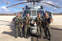 Aircrew from the Island Knights of Helicopter Sea Combat Squadron (HSC) 25 pose for a group photo. The aircrew assisted in the assisted in the recovery of two persons in distress 13 miles northwest of the Northern Mariana island of Tinian, June 18. From left to right: Naval Aircrewman 2nd Class Jordan Hunton (Crew Chief), Lt. Amanda Lowery (Aircraft Commander), Lt. Kristin Bowen (Co-pilot), and Naval Aircrewman 2nd Ernesto Rodriguez (Aircrew Swimmer). (U.S. Navy/ADAN Guillermo Torres)