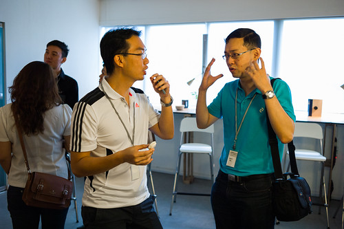 Kevin Teo of macarons.sg (right) chatting with a UCP participant about his business.