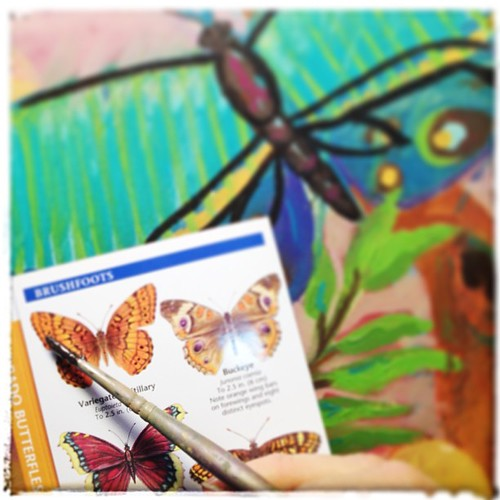 Working on the next stages of my new #painting - consulting my #Colorado butterfly guide to get my winged friend looking great!