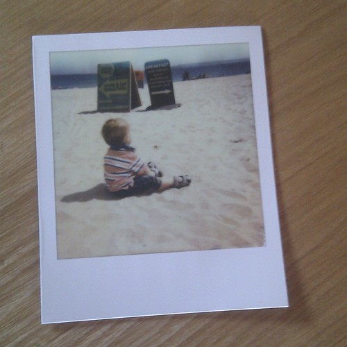 My boy on the beach in Polaroid by PhotoPuddle