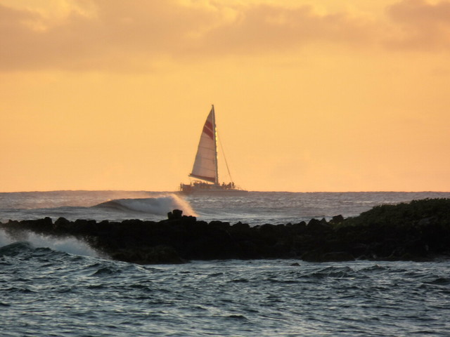 Sailboat near sunset near Poipu, south shore of Kauai, Hawaii, July 2013