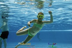 freestyle swimming(0.0), underwater(0.0), swimming pool(1.0), swimming(1.0), sports(1.0), recreation(1.0), outdoor recreation(1.0), leisure(1.0), underwater sports(1.0), swimmer(1.0), water sport(1.0),