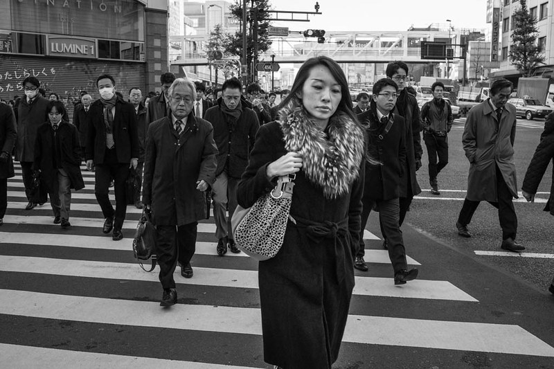 A woman leads the way across the crossing near Shinjuku station. In Japan, gender equality is still an issue being worked on.