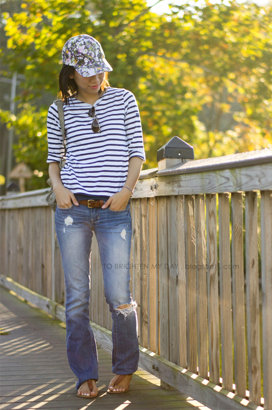 floral cap, striped top, jeans