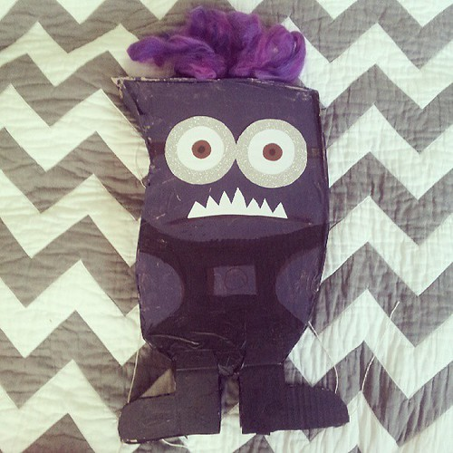 The purple minion pinata. Photo now because it could go all wrong once he's up on the tree. #5yroldpartymadness #despicableme
