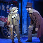 A Christmas Carol, The Musical - Pictured L-R: Vincent Rodriguez (Tiny Tim) and Cole Burden (Bob Cratchit) Photo Credit P. Switzer Photography 2013