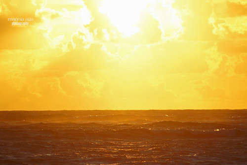 ocean light summer sky sun sunlight nature water clouds sunrise golden glow dominicanrepublic horizon surface 75300mm tones atlanticocean puntacana flamingstar thegalaxy infinitexposure riunaiboaresort