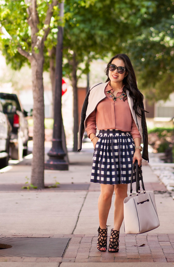 cute & little blog | petite fashion | khaki black leather sleeves jacket, pink blouse, gingham check skirt, caged sandals, statement necklace | spring outfit