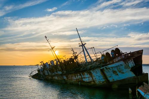 sunset sea abandoned ship