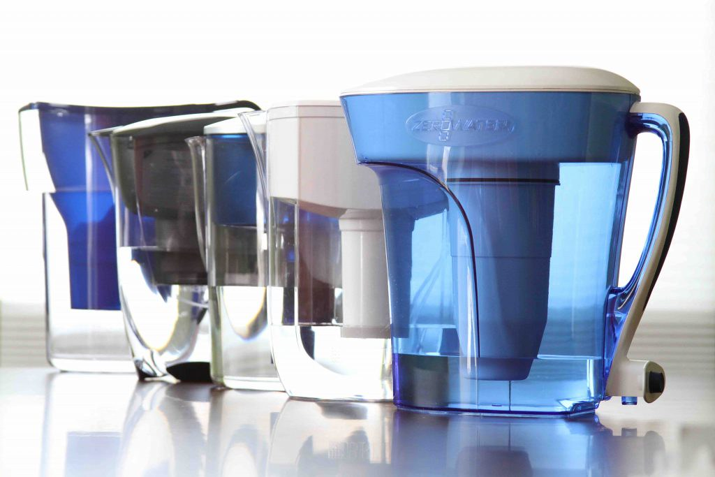 Group of water filter pitchers on table