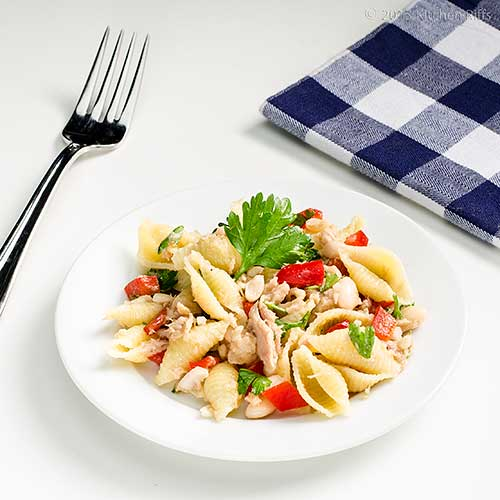 Pasta, Bean, and Tuna Salad on plate with fork, and napkin