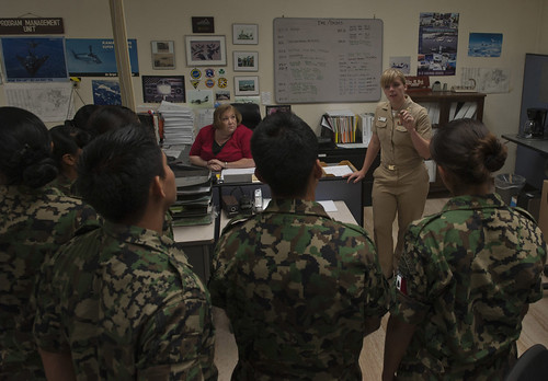 LTJG Kiara Jaybush, supply explains the mission of the program management unit at ASD to midshipmen from the Mexican navy.