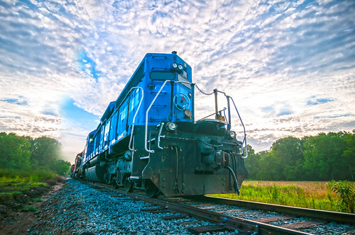 blue freight train engine at sunrise by DigiDreamGrafix.com