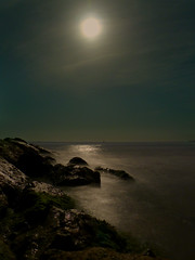 Seascape under a blue moon.