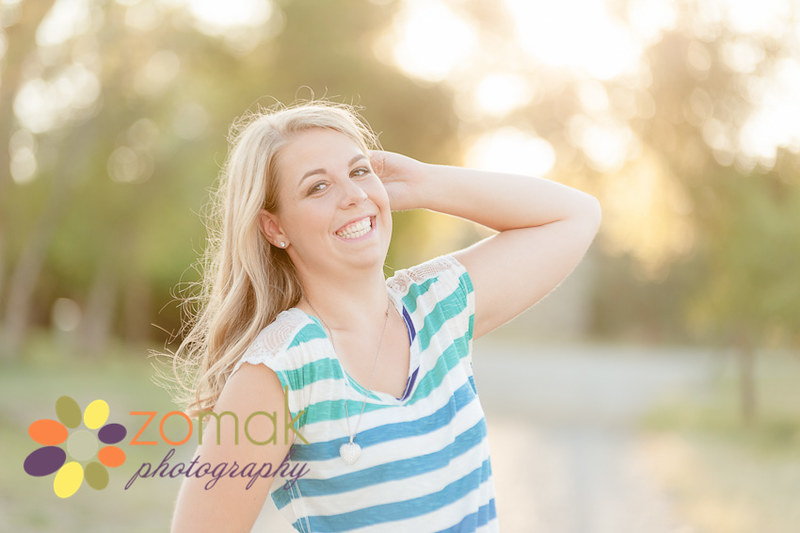 Helena High Class of 2014 senior smiling at sunset in a backlit location
